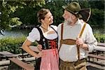 A traditionally clothed German man and woman in a beer garden Stock Photo - Premium Royalty-Free, Artist: Beyond Fotomedia, Code: 653-03079683