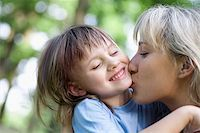 A mother and daughter kissing Stock Photo - Premium Royalty-Freenull, Code: 653-03079824