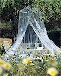 Cosy seat beneath a mosquito net Stock Photo - Premium Royalty-Free, Artist: Sheltered Images, Code: 689-03123719