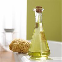 Grapeseed oil and sponge on the bathtub border Stock Photo - Premium Royalty-Freenull, Code: 689-03124264