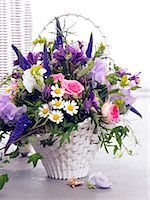 Basket with roses,vetches,veronica,chamomille and columbines Stock Photo - Premium Royalty-Freenull, Code: 689-03124912