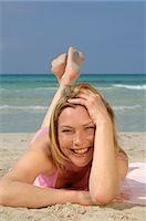 sandi model - Woman is lying on the beach Stock Photo - Premium Royalty-Freenull, Code: 689-03125387