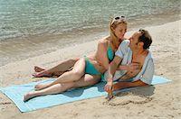 sandi model - Couple on the beach on a mat Stock Photo - Premium Royalty-Freenull, Code: 689-03125413