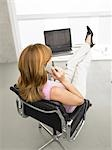 Business woman phoning with legs on the desk Stock Photo - Premium Royalty-Freenull, Code: 689-03125858
