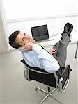 Telephoning business man having his legs on his desk Stock Photo - Premium Royalty-Freenull, Code: 689-03125916