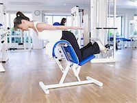 rehabilitation - workout at the torso lifter Stock Photo - Premium Royalty-Freenull, Code: 689-03130601