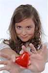 Girl with chocolate heart Stock Photo - Premium Royalty-Free, Artist: Peter Griffith, Code: 689-03130851
