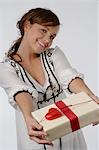 Girl with present Stock Photo - Premium Royalty-Free, Artist: Ikon Images, Code: 689-03130854