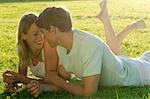 Young couple lying on lawn Stock Photo - Premium Royalty-Free, Artist: Dazzo, Code: 689-03130869