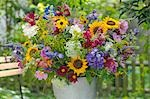 Flowers on the garden table Stock Photo - Premium Royalty-Freenull, Code: 689-03131105