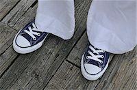 Woman Wearing Sneakers Stock Photo - Premium Royalty-Freenull, Code: 600-03152220