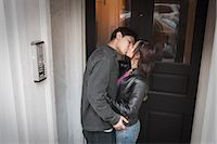 Young Couple Kissing in Doorway                                                                                                                                                                          Stock Photo - Premium Rights-Managednull, Code: 700-03152526