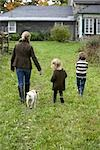 Mother and Children Walking towards House                                                                                                                                                                Stock Photo - Premium Rights-Managed, Artist: Michael Alberstat        , Code: 700-03152716