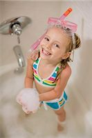 Girl with Snorkel in Bathtub Stock Photo - Premium Royalty-Freenull, Code: 600-03152946