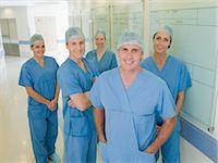 Team of surgeons in hospital corridor                                                                                                                                                                    Stock Photo - Premium Royalty-Freenull, Code: 635-03161368