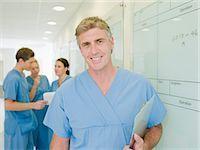 Surgeon standing in hospital corridor                                                                                                                                                                    Stock Photo - Premium Royalty-Freenull, Code: 635-03161495