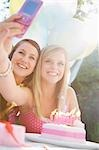 Teenaged girls at birthday party taking a self portrait  with mobile phone Stock Photo - Premium Rights-Managed, Artist: ableimages, Code: 822-03161725