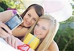 Teenaged girls at birthday party taking a self portrait  with mobile phone Stock Photo - Premium Rights-Managed, Artist: ableimages, Code: 822-03161740