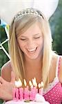 Close up of a smiling teenaged girl and birthday cake Stock Photo - Premium Rights-Managed, Artist: ableimages, Code: 822-03161754