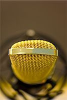 Extreme close up of a gold microphone Stock Photo - Premium Rights-Managednull, Code: 822-03161923