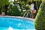 Woman walking along the side of a swimming pool Stock Photo - Premium Rights-Managed, Artist: ableimages, Code: 822-03161966