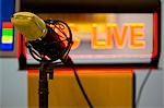 Close up of a gold microphone and illuminated sign Stock Photo - Premium Rights-Managed, Artist: ableimages, Code: 822-03162043