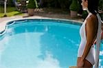 Profile of a woman standing by a swimming pool Stock Photo - Premium Rights-Managed, Artist: ableimages, Code: 822-03162081