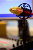 Close up of a gold microphone on a pedestal Stock Photo - Premium Rights-Managednull, Code: 822-03162089