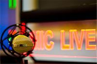 Close up of a gold microphone and illuminated sign Stock Photo - Premium Rights-Managednull, Code: 822-03162115