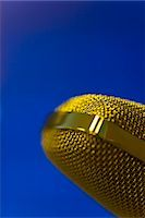Extreme close up of a gold microphone Stock Photo - Premium Rights-Managednull, Code: 822-03162116