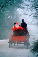 1990s 1994 SANTA IN HORSE-DRAWN WAGON DIRT ROAD REAR VIEW Stock Photo - Premium Rights-Managednull, Code: 846-03163149
