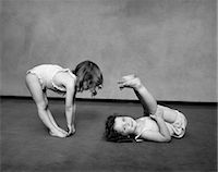 1930s TWO GIRLS WEARING UNDERCLOTHES PLAYING AT EXERCISING Stock Photo - Premium Rights-Managednull, Code: 846-03163500