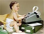 1960s BABY WEARING CLOTH DIAPER SITTING IN BOOSTER CHAIR USING ADDING MACHINE CALCULATOR