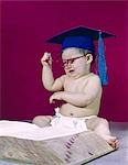 1960s GRADUATE PROFESSOR BABY WEARING ACADEMIC CAP MORTARBOARD EYEGLASSES READING BOOK DICTIONARY ANGRY FRUSTRATED