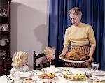 1960s TURKEY DINNER CHILDREN GRANDMOTHER Stock Photo - Premium Rights-Managed, Artist: ClassicStock, Code: 846-03164109