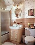 1960s INTERIOR OF BEIGE TILED BATH BATHROOM WITH POLKA DOT WALL PAPER GLASS ENCLOSED TUB SHOWER