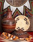 1980s STILL LIFE OF NATIVE AMERICAN ARTS AND CRAFTS INCLUDING INDIAN BASKET POTTERY AND JEWELRY