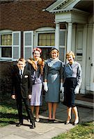 1950s MOTHER WITH TEENAGE GIRLS & YOUNGER SON DRESSED UP POSING IN FRONT OF HOUSE Stock Photo - Premium Rights-Managednull, Code: 846-03164800