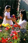 MOTHER IN GARDEN WITH DAUGHTER