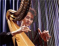1960s WOMAN PLAYING HARP PLUCKING STRINGS Stock Photo - Premium Rights-Managednull, Code: 846-03165054