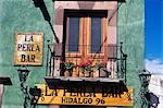SAN MIGUEL D ALLENDE, MEXICO PAINTED BALCONY OVER BAR Stock Photo - Premium Rights-Managed, Artist: ClassicStock, Code: 846-03165434