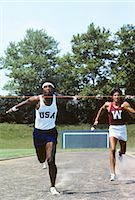 finish line - 1970s AFRICAN AMERICAN MAN ATHLETE BREAKING TAPE AT FINISH LINE WINNING THE RACE Stock Photo - Premium Rights-Managednull, Code: 846-03165810