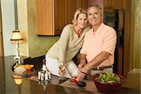 Couple in Kitchen Preparing Dinner Stock Photo - Premium Rights-Managednull, Code: 700-03171702