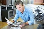Man in Appliance Store Reading Brochures Stock Photo - Premium Rights-Managed, Artist: Ron Fehling, Code: 700-03178530