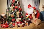 Santa Claus Putting Toys Under the Christmas Tree