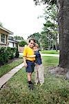 Brothers Hugging Stock Photo - Premium Royalty-Free, Artist: Mark Peter Drolet, Code: 600-03178830