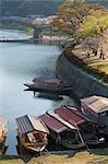 Boats tied along Nishiki river, Iwakuni. Yamaguchi Prefecture, Chugoku, Japan