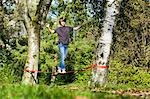 Boy Slacklining Stock Photo - Premium Rights-Managed, Artist: Bryan Reinhart, Code: 700-03179148