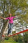 Woman Slacklining Stock Photo - Premium Rights-Managed, Artist: Bryan Reinhart, Code: 700-03179151