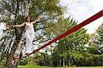 Woman Slacklining Stock Photo - Premium Rights-Managed, Artist: Bryan Reinhart, Code: 700-03179157